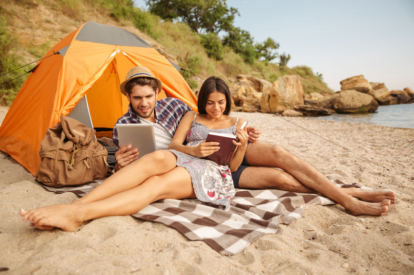 Honeymooners reading on the beach