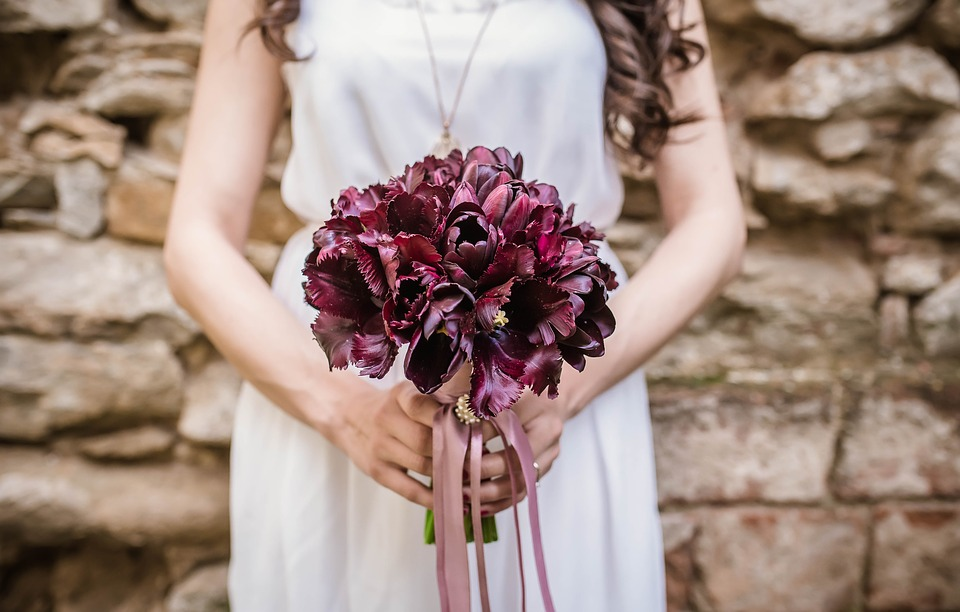 Focus on the bride with flowers