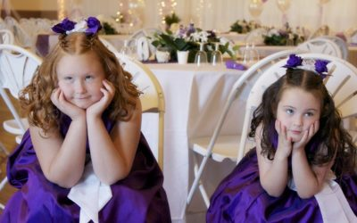 Bored flowergirls at wedding