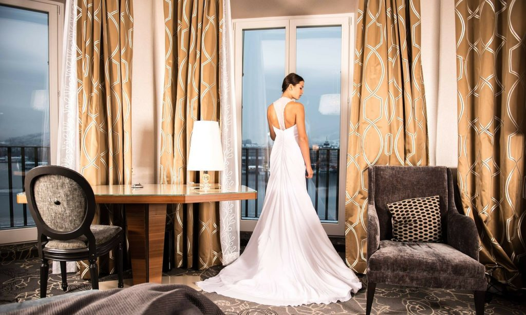 Bride dressing at hotel
