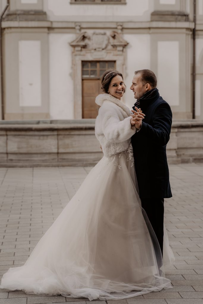 Bride & groom dressed for winter