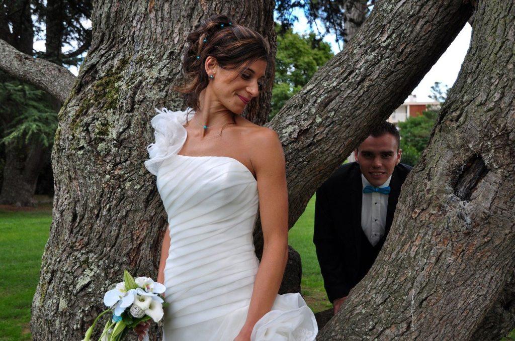 Bride & groom by tree
