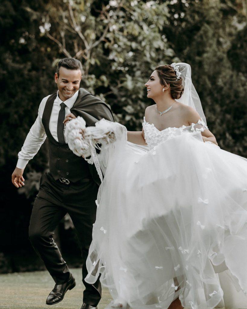 Bride & grown leaving the wedding