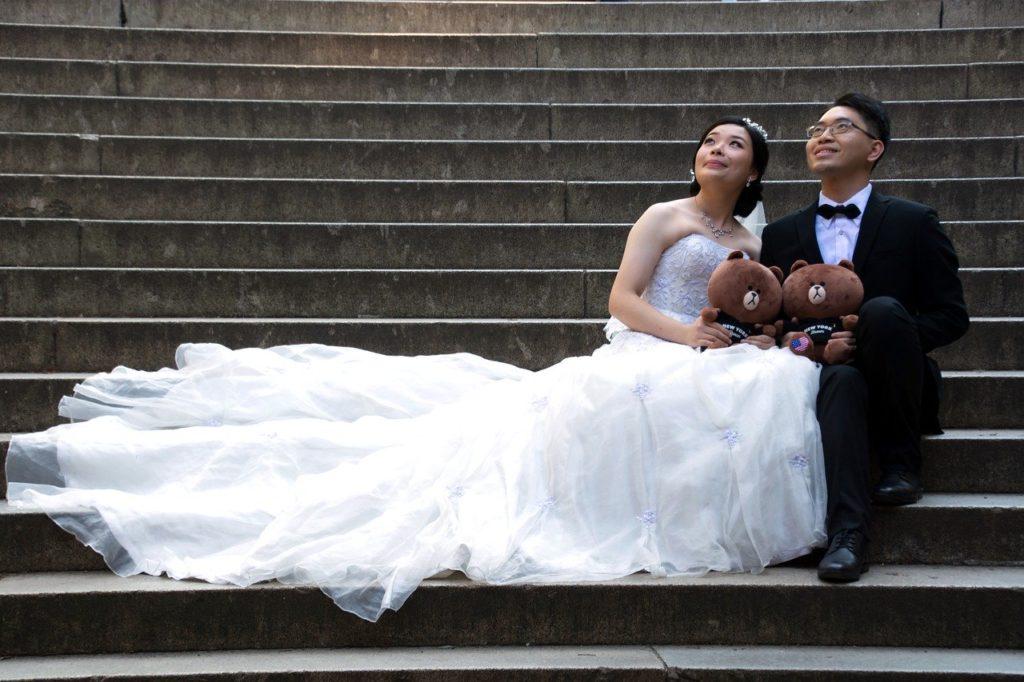 Bride & grown on stone steps