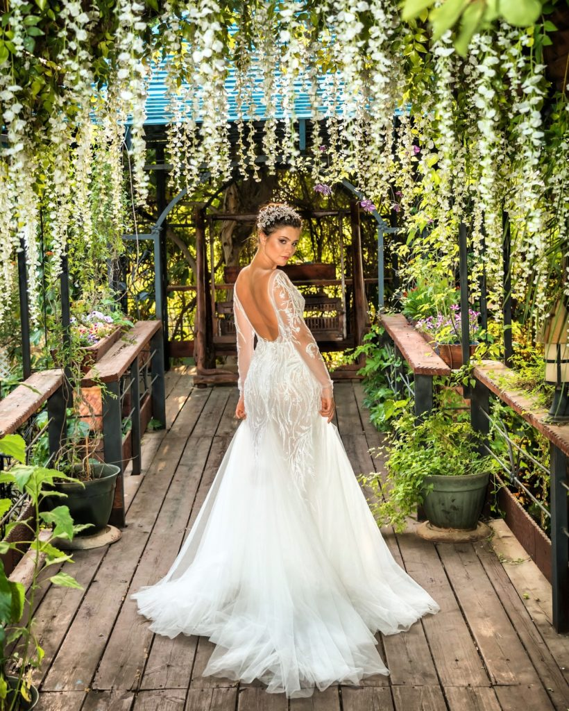 woman-in-white-wedding-gown-standing-on-brown-wooden-pathway-3739003