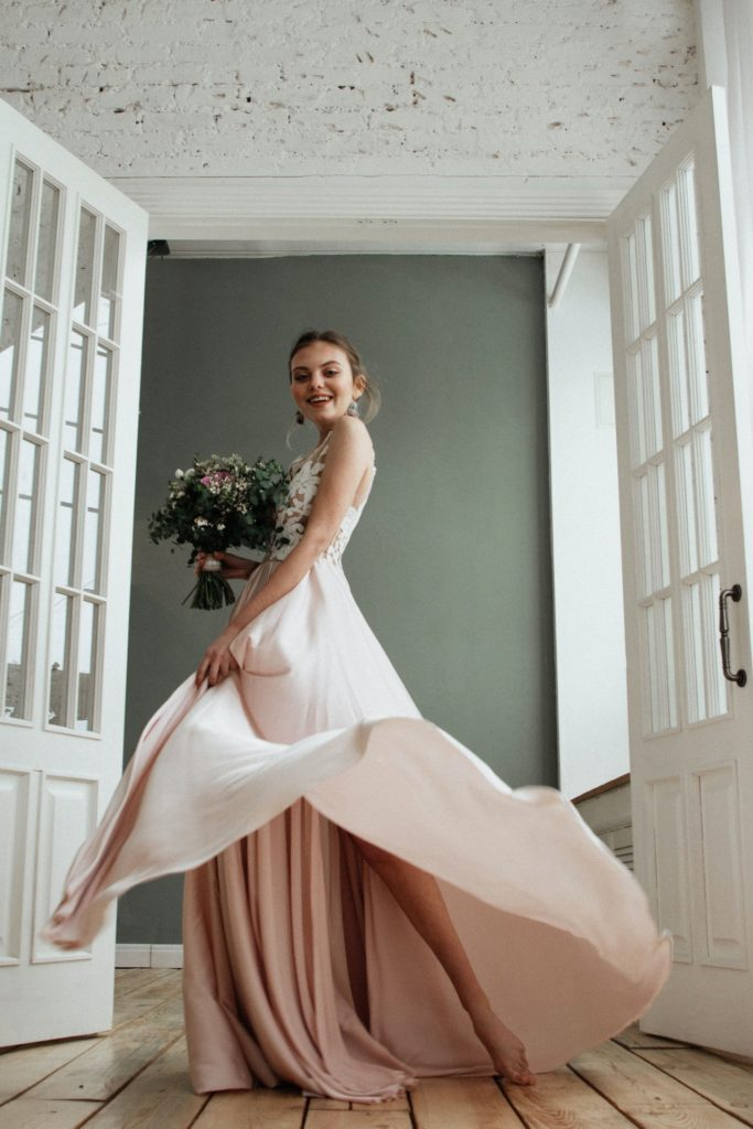 bride in white dress with brown underskirt