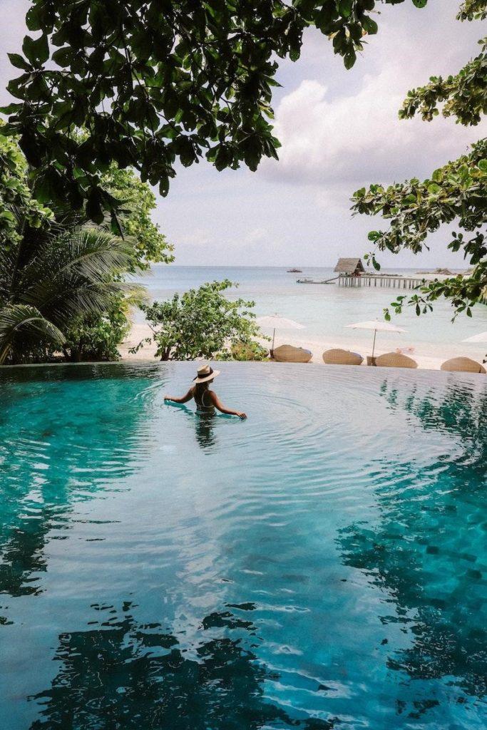 Man swiming in pool overlooking lake