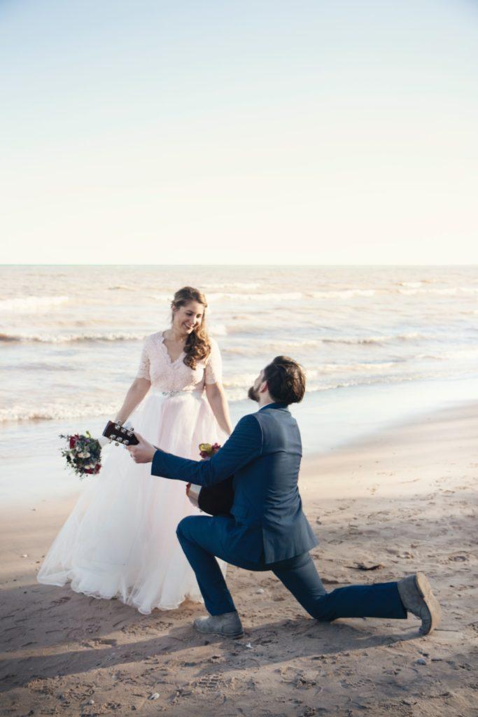 searding the bride on the beach