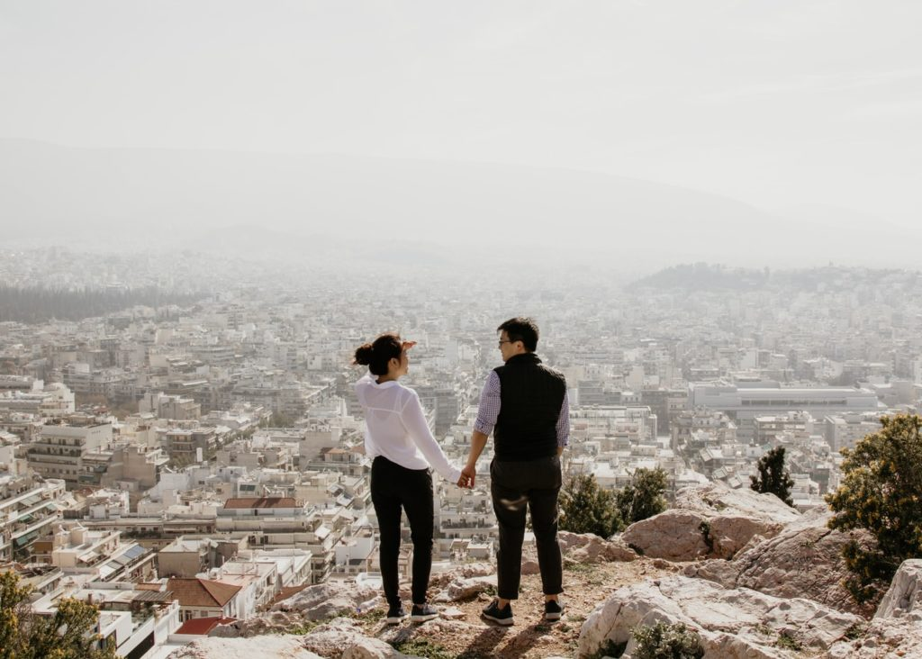 couple in Athens Greece overlooking city
