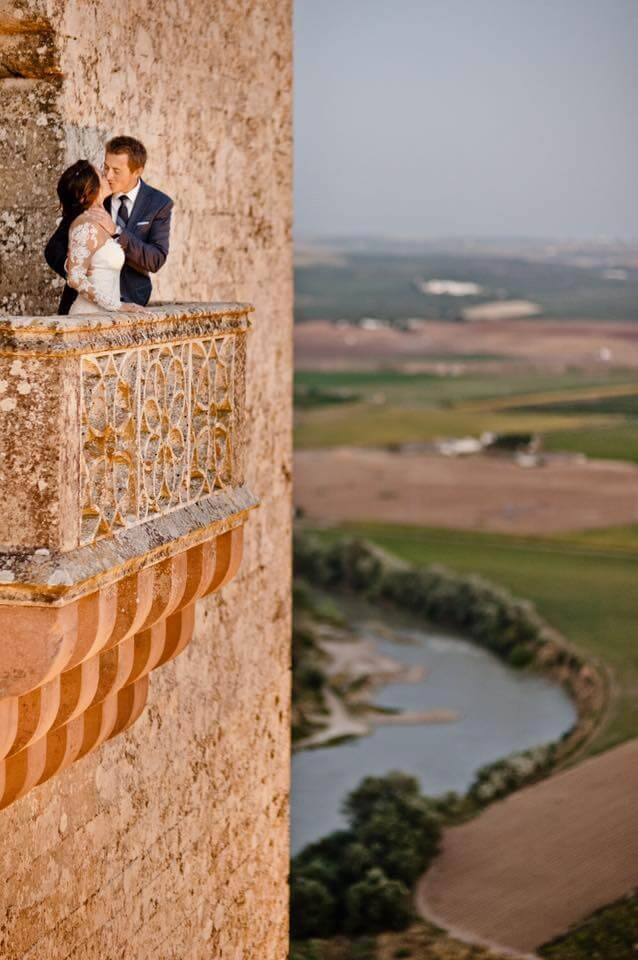 Wedding couple on castle balcony